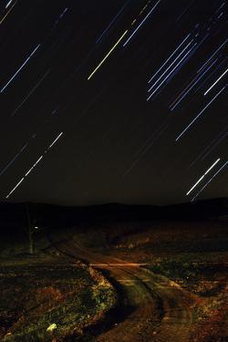 Star Trails over a Road in the Alamut Valley. Sirius, and Orion's Stars are the Brightest Trails by Babak Tafreshi