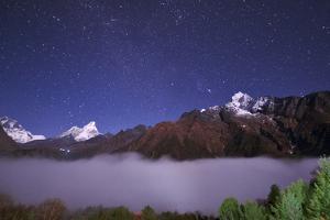 Starry Sky over Mount Lhotse. Gemini Above Ama Dablam. Orion over Mount Thamserku by Babak Tafreshi