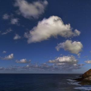 Stars and Cumulus Clouds on a Moonlit Night on the Atlantic Coast of Tenerife Island by Babak Tafreshi