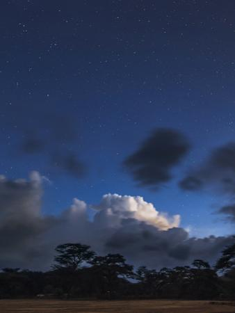Stars Emerge in the Evening Twilight over Cumulus Clouds Near the Equator in Kenya by Babak Tafreshi