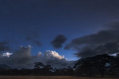 Stars Emerge in the Evening Twilight over Cumulus Clouds Near the Equator in Kenya