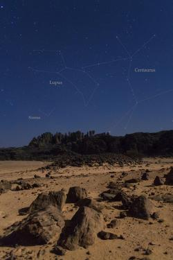 Stars of Constellation Centaurus, Lupus and Norma Appear Above Sandstone Cliffs by Babak Tafreshi