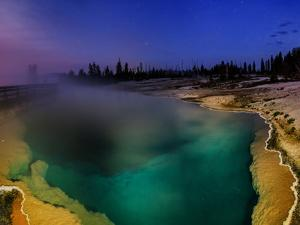 Steam Rising from a Deep Geothermal Hot Spring Pool at Dawn by Babak Tafreshi
