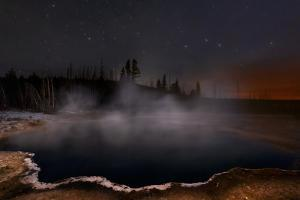 Steam Rising from a Geothermal Hot Spring under the Northern Stars by Babak Tafreshi