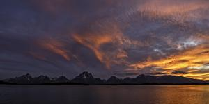 Sunset Colors over the Tetons and the Jackson Lake Dam by Babak Tafreshi