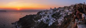 Sunset over the Aegean Sea Seen from a Cliff-Top Town on Santorini Island by Babak Tafreshi