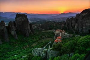 Sunsets over Monasteries Built into Sandstone Pillars by Babak Tafreshi