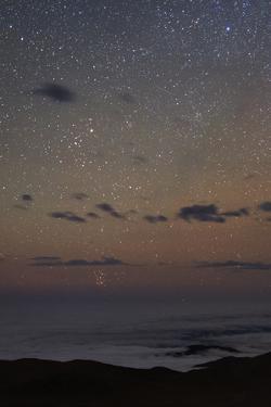 Taurus, and the Pleiades and Hyades Star Clusters on the Horizon. a Faint Meteor Streaks the Sky by Babak Tafreshi