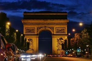 The Arc De Triomphe, and Champs-Elysees Avenue with Traffic at Night by Babak Tafreshi