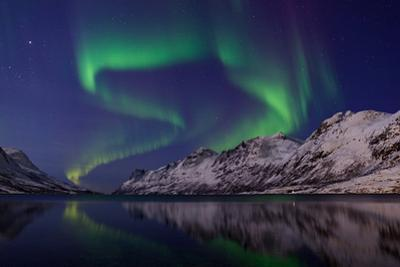The Aurora Borealis over Water and Mountains. Jupiter in the Constellation Taurus, on Upper Left