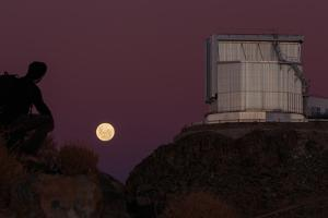 The Full Moon Rises in the Evening Sky of La Silla Observatory by Babak Tafreshi