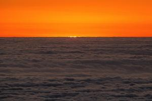 The Last Rays of the Sun over a Sea of Clouds, Seen from a Mountain Top in the Atacama Desert by Babak Tafreshi