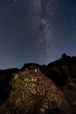 The Milky Way Above an Ancient Native American Petroglyph in the Owens Valley of Sierra by Babak Tafreshi