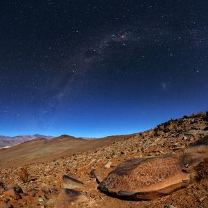 The Milky Way Above an Ancient Petroglyph in the Desert by Babak Tafreshi