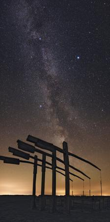 The Milky Way Above the Hortobagy National Park and its Traditional T-Shaped Sweep Wells by Babak Tafreshi