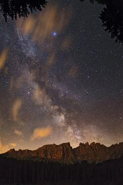 The Milky Way and a Star-Filled Sky Above Latemar Mountain by Babak Tafreshi