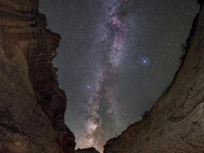 The Milky Way and stars of the Summer Triangle over walls of a gorge. by Babak Tafreshi