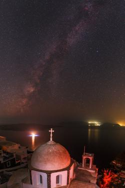 The Milky Way and the Summer Triangle over the Aegean. Boat Lights and City Lights Cast Reflections by Babak Tafreshi