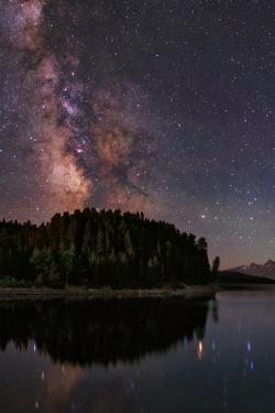 The Milky Way Appears in Constellation Scorpius and Sagittarius over the The Jackson Lake Dam by Babak Tafreshi