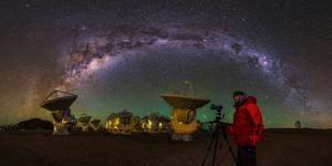 The Milky Way Appears over a Photographer and the Alma Radio Telescopes by Babak Tafreshi