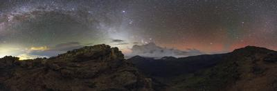 The Milky Way Arch with Orion and Taurus and a Red Airglow over Haleakala Crater by Babak Tafreshi