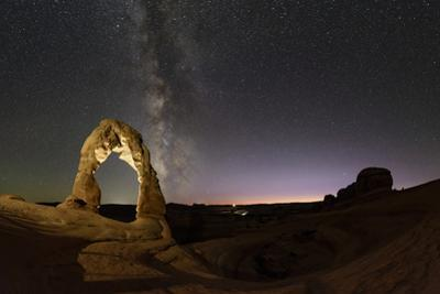 The Milky Way Emerges from the Evening Twilight over the Delicate Arch by Babak Tafreshi