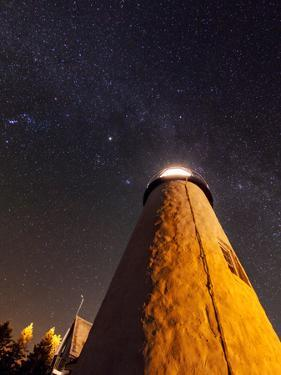The Milky Way in Orion and Taurus, and the Bright Point, Jupiter, over the Pemaquid Lighthouse by Babak Tafreshi