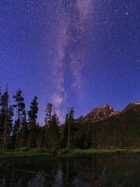 The Milky Way in the Morning Twilight over the Teton Range and a Scenic Forest Lake by Babak Tafreshi