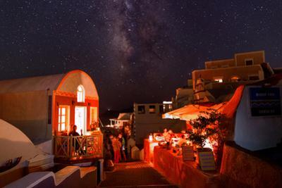 The Milky Way over Candle-Lit Restaurants During a Black-Out by Babak Tafreshi