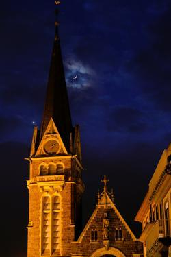 The Moon and Venus Pairing in a Conjunction over a Church at Night by Babak Tafreshi
