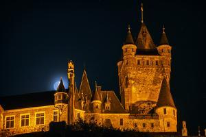 The Moon, Illuminated Sunlight Reflected on Earth's Surface, Behind the Imperial Castle of Cochem by Babak Tafreshi