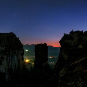The Night Sky Above the Sandstone Pillars of the World Heritage Site of Meteora by Babak Tafreshi