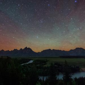 The Night Sky over Grand Teton National Park and the Snake River by Babak Tafreshi