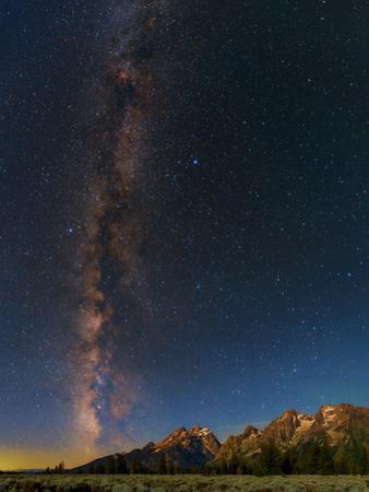 The Night Sky over the Grand Teton National Park by Babak Tafreshi