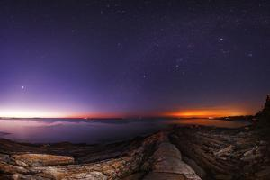 The Night Sky with Morning Twilight, Zodiacal Light, Venus, the Milky Way, Jupiter, and City Lights by Babak Tafreshi