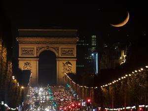 The Setting Crescent Moon at the Arc De Triomphe and Champs-Elysees Avenue by Babak Tafreshi