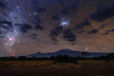 The Southern Milky Way and Magellanic Clouds over Kilimanjaro. the Red Cloud Is the Carina Nebula by Babak Tafreshi