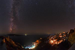 The Summer Milky Way over the Aegean Sea and Town of Oia During a Fire Caused Black-Out by Babak Tafreshi