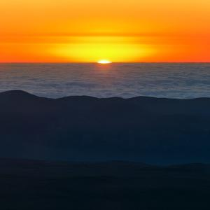 The Sun Sets over the Pacific Ocean and the Atacama Desert by Babak Tafreshi