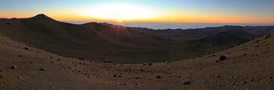The Sun Setting over the Atacama Desert and the Paranal Observatory on the Peak of Cerro Paranal by Babak Tafreshi