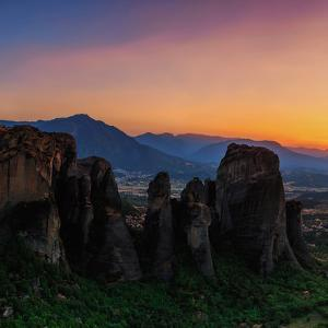 The Sunset over the Sandstone Pillars of the World Heritage Site Meteora by Babak Tafreshi