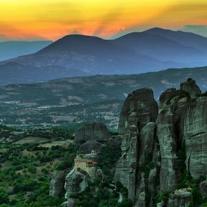 The Sunsets over Monasteries Built into Sandstone Pillars by Babak Tafreshi