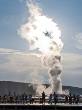 Tourists Watching an Eruption of the Old Faithful Geyser by Babak Tafreshi
