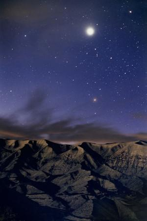 Venus Glows at Dawn with Rising Stars of Scorpius over Snowy Mountains by Babak Tafreshi