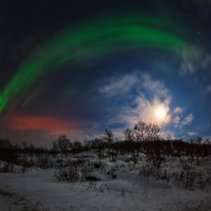 View of the Aurora Borealis, Northern Lights, Moon, and Scattered Light Pollution by Babak Tafreshi