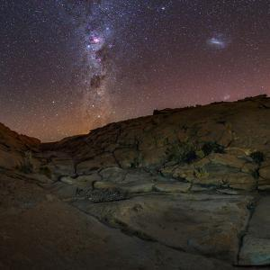 View of the Milky Way Above a Small Canyon in the Atacama Desert by Babak Tafreshi
