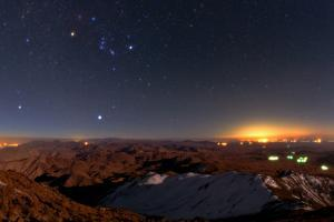 Winter Stars, Including Sirius and the Prominent Constellation Orion, Rise Above Zagros Mountains by Babak Tafreshi