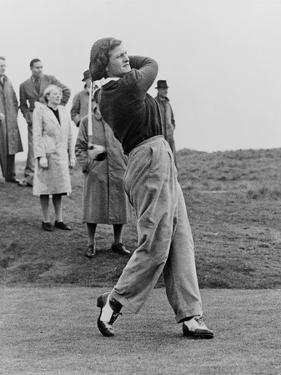 Babe Didrikson, Watching Golf Ball as She Completes Her Swing