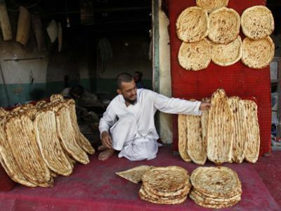 Baker Arranges Breads at His Shop in Kandahar Province, South of Kabul, Afghanistan