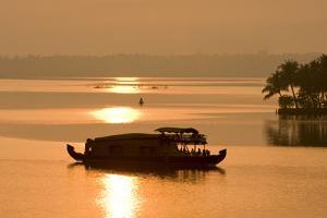 Houseboat at Dusk in Ashtamudi Lake, Kollam, Kerala, India, Asia by Balan Madhavan